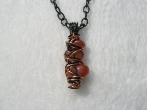 "Halloween Inspired ""Orange is the New Black"" Carnelian Wire Wrapped Pendant Necklace https://www.etsy.com/listing/248451970/halloween-inspired-orange-is-the-new?ref=shop_home_active_3"